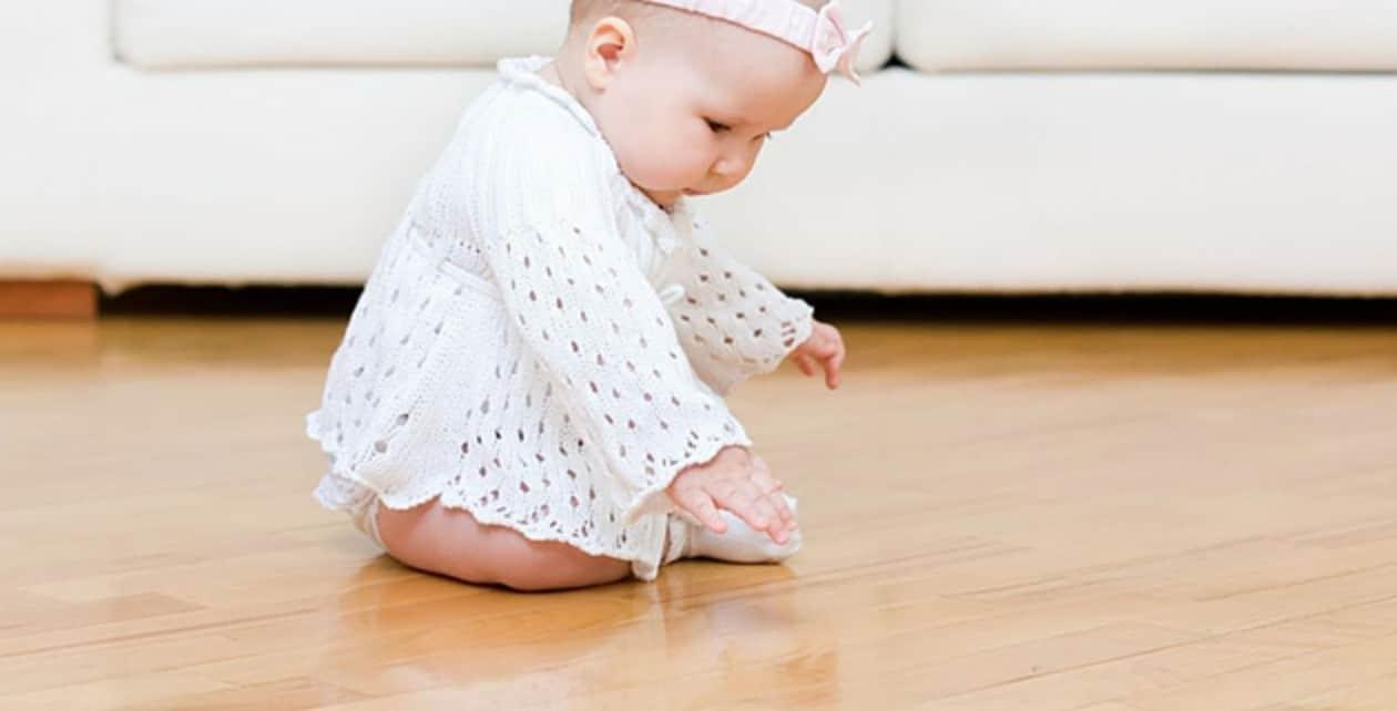 baby on vinyl floor