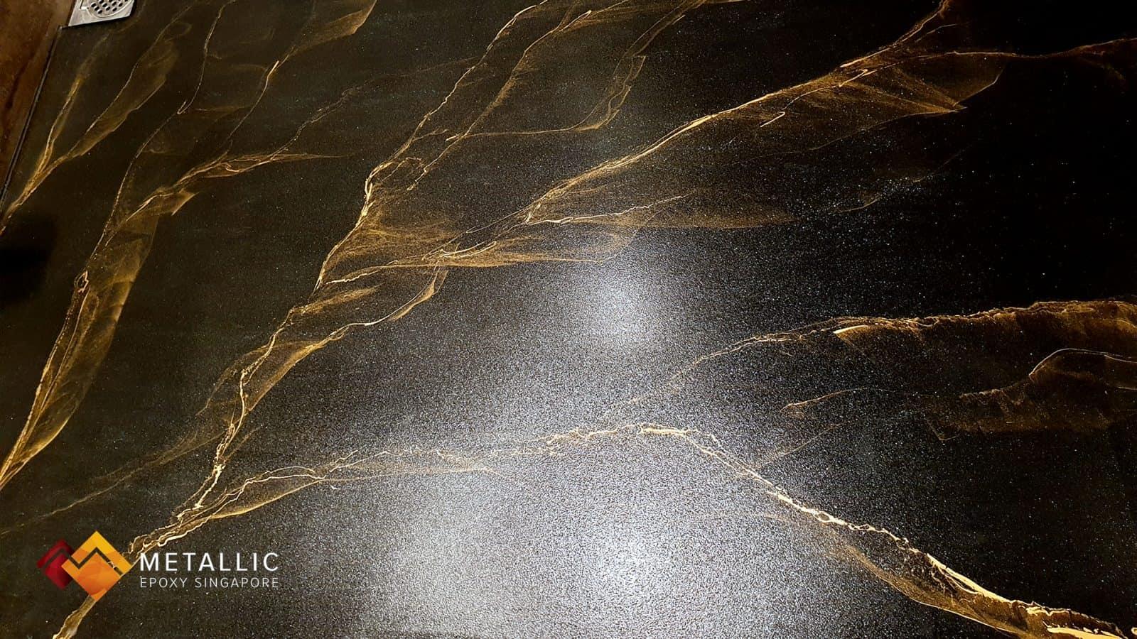 Gold Streaks on black toilet floor