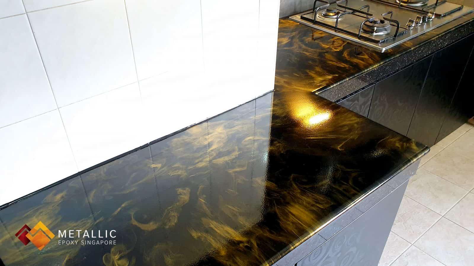 Metallic Epoxy Orange Gold on Black Kitchen Countertop