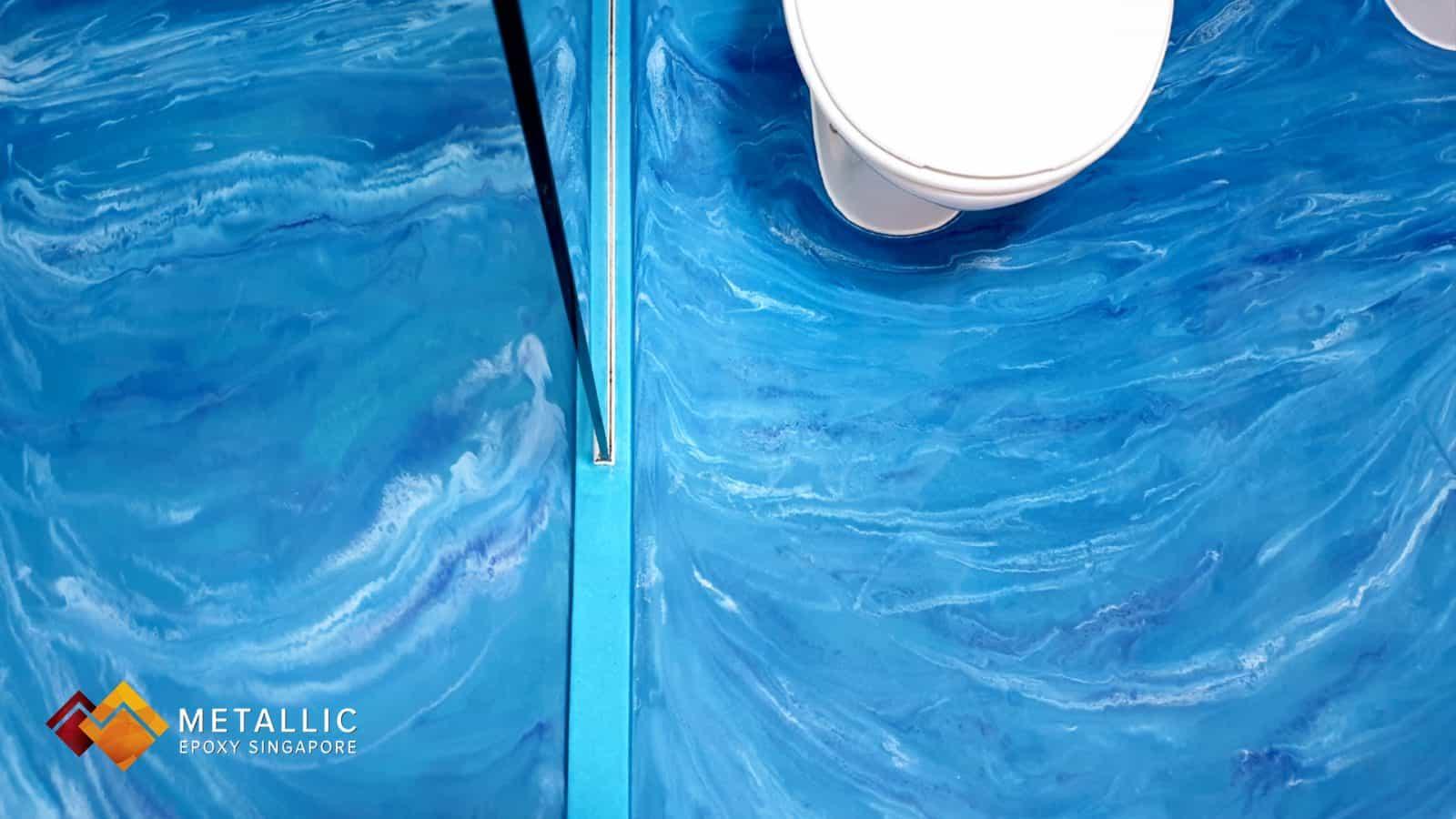Metallic epoxy singapore blue waves bathroom floor